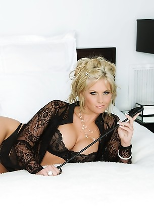 Phoenix Marie, commanding and domineering in her black lacy lingerie and leather heeled boots, is ready to whip you in shape with her riding crop!
